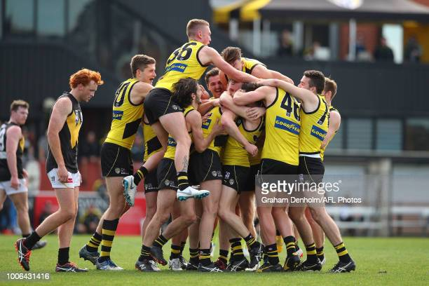 Richmond celebrate a goal by Ryan Garthwaite during the round 17 VFL match between Richmond and Werribee at Punt Road Oval on July 28, 2018 in...