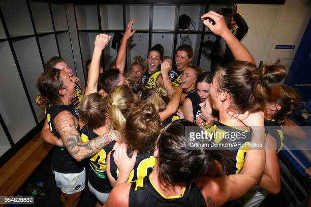 Richmond celebrate in the dressing rooms following the round one AFLW match between the Western Bulldogs and Richmond at Whitten Oval on May 5, 2018...