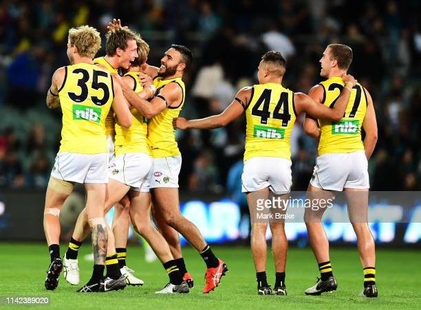 Richmond celebrate the final siren 2during the round four AFL match between the Port Adelaide Power and the Richmond Tigers at Adelaide Oval on April...