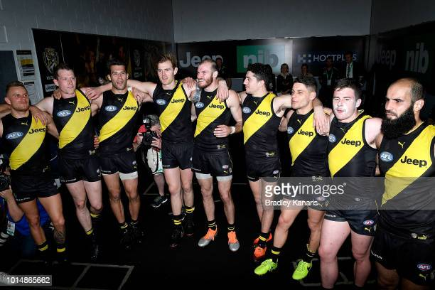 Richmond celebrate victory after the round 21 AFL match between the Gold Coast Suns and the Richmond Tigers at Metricon Stadium on August 11 2018 in...