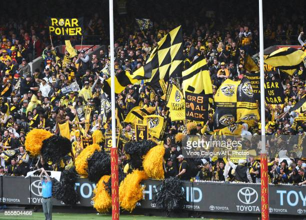 Richmond cheer squad celebrate goal in 3rd Qtr during the 2017 AFL Grand Final match between the Adelaide Crows and the Richmond Tigers at Melbourne...