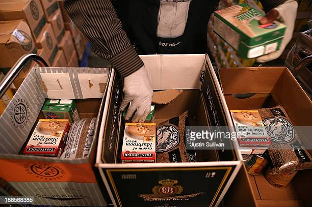 Richmond Emergency Food Bank volunteer Abdul Olorode packs boxes with food to be handed out to needy people on November 1 2013 in Richmond California...