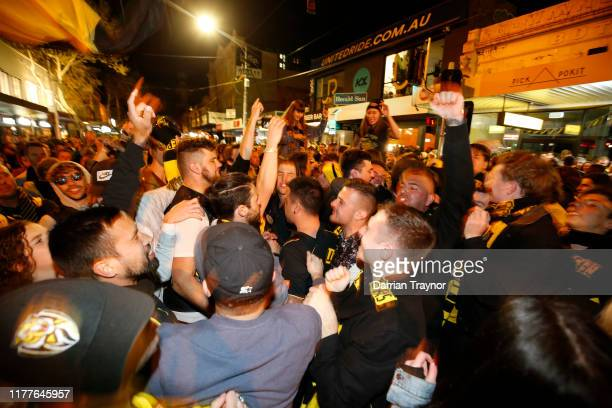 Richmond fans celebrate in Swan Street after the 2019 AFL Grand Final at the Melbourne Cricket Ground on September 28, 2019 in Melbourne, Australia....