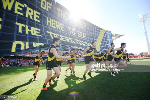 Richmond head out during the round 21 AFL match between the Gold Coast Suns and the Richmond Tigers at Metricon Stadium on August 11 2018 in Gold...