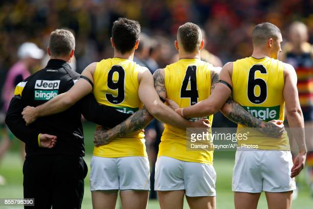 Richmond players line up for the national anthem before the 2017 AFL Grand Final match between the Adelaide Crows and the Richmond Tigers at...