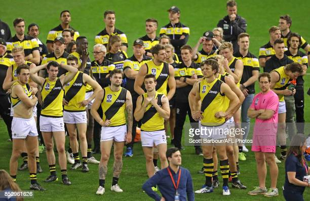 Richmond players react after losing the VFL Grand Final match between Richmond and Port Melbourne at Etihad Stadium on September 24 2017 in Melbourne...
