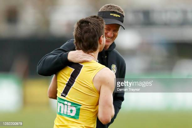 Richmond senior coach, Damien Hardwick shares a laugh with Liam Baker during a Richmond Tigers AFL training session at Casey Fields on June 25, 2020...