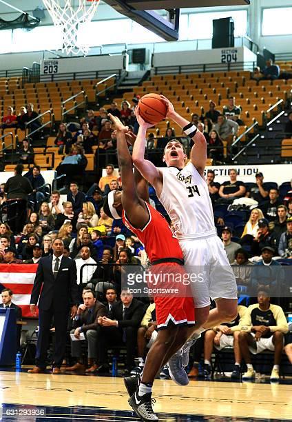 Richmond Spiders guard De'Monte Buckingham defends against George Washington Colonials forward Tyler Cavanaugh during an Atlantic 10 men's basketball...