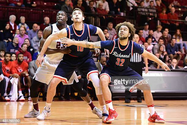 Richmond Spiders guard Julius Johnson and Richmond Spiders forward TJ Cline fights for position with Saint Joseph's Hawks forward Markell Lodge...