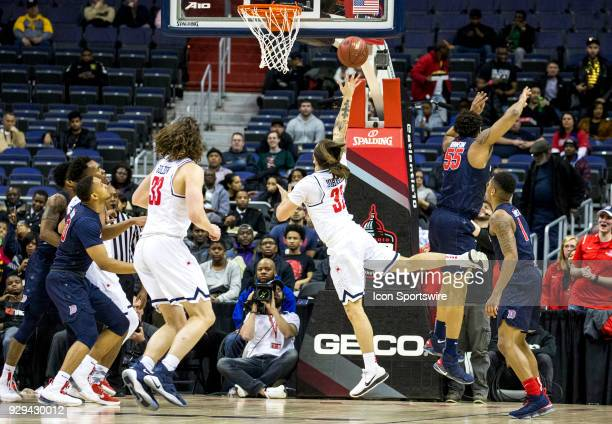 Richmond Spiders guard Julius Johnson shoots an off balance shot during a second round game of the 2018 Atlantic 10 men's basketball championship...