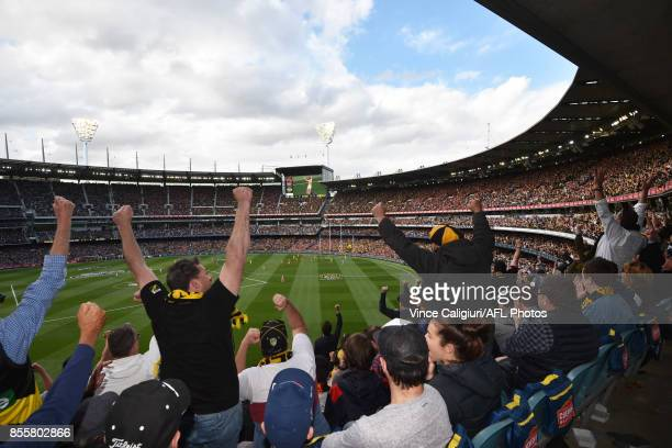 Richmond supporters celebrate goal in 3rd Qtr during the 2017 AFL Grand Final match between the Adelaide Crows and the Richmond Tigers at Melbourne...