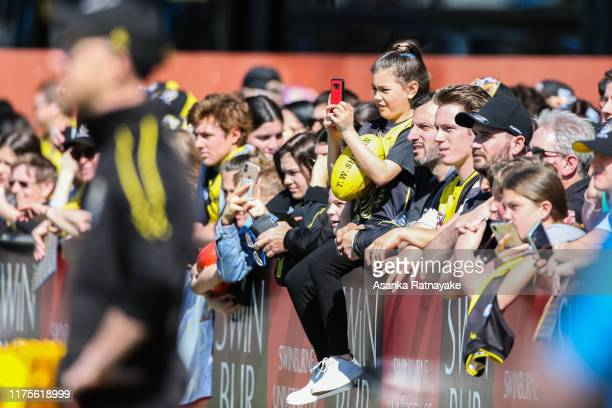 Richmond supporters on the boundary line look on as the Tigers train during a Richmond Tigers AFL training session at Punt Road Oval on September 19...