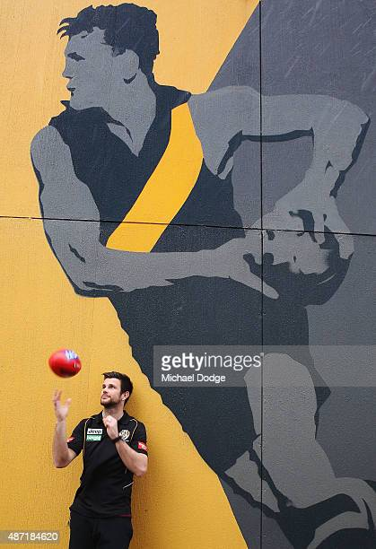 Richmond Tigers Captain Trent Cotchin poses with a painted image of legend Tigers captain Jack Dyer during the AFL Finals Series Launch press...