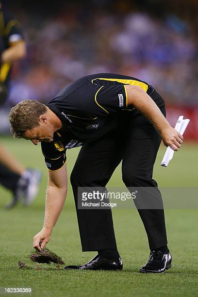 Richmond Tigers coach Damien Hardwick replaces the turf during the round one AFL NAB Cup match between the Richmond Tigers and the Melbourne Demons...