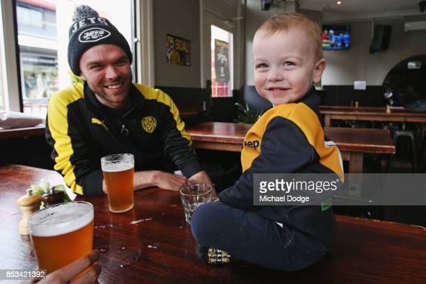 Richmond Tigers fan Lachlan Fox relaxes with son Jack while having a quite ale at the Swan Hotel on September 25 2017 in Melbourne Australia The...
