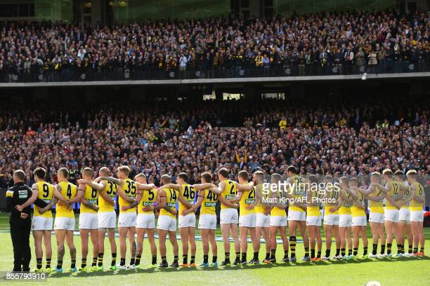 Richmond Tigers line up for the national anthem during the 2017 AFL Grand Final match between the Adelaide Crows and the Richmond Tigers at Melbourne...