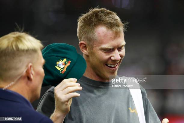 Richmond Tigers player Jack Riewoldt is seen holding Shane Warne's baggy green cap, ahead of the Big Bash League match between the Melbourne...