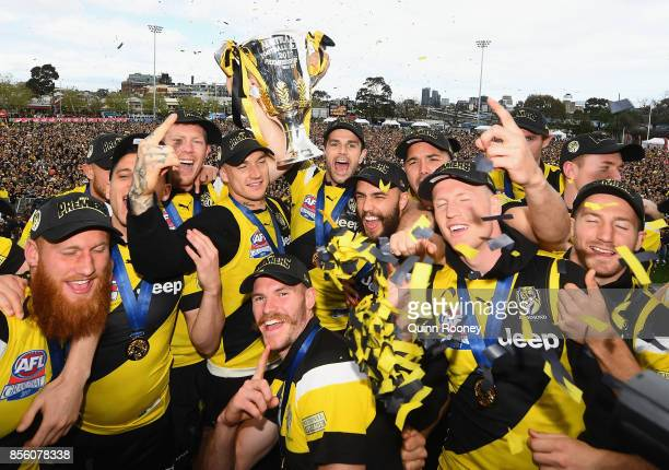 Richmond Tigers players celebrate with the Premiership Trophy after winning yesterday's AFL Grand Final, at Punt Road Oval on October 1, 2017 in...