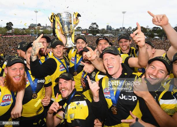 Richmond Tigers players celebrate with the Premiership Trophy after winning yesterday's AFL Grand Final at Punt Road Oval on October 1 2017 in...