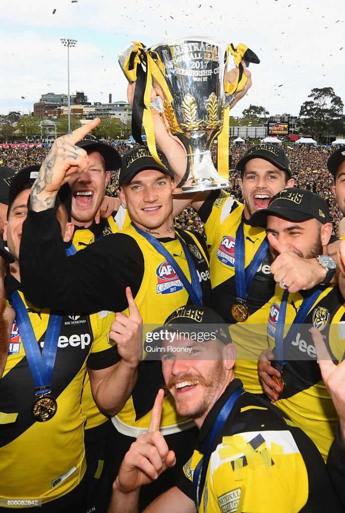 Richmond Tigers players celebrate with the Premiership Trophy after winning yesterday's AFL Grand Final, at Punt Road Oval on October 1, 2017 in Melbourne, Australia.