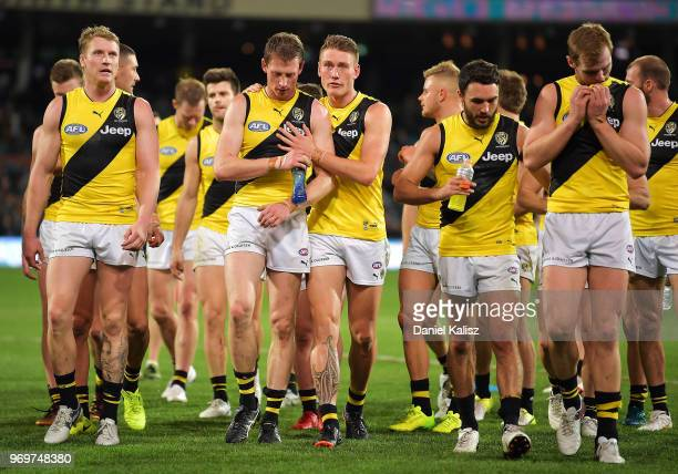 Richmond Tigers players walk from the field after the round 12 AFL match between the Port Adelaide Power and the Richmond Tigers at Adelaide Oval on...