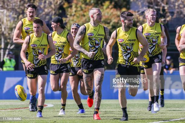 Richmond Tigers players warm up during a Richmond Tigers AFL training session at Punt Road Oval on September 19, 2019 in Melbourne, Australia.