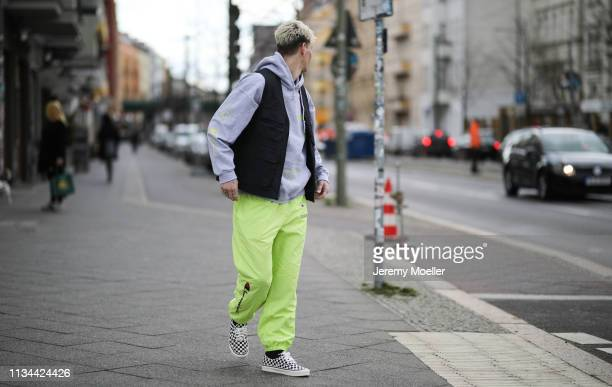 Richy Koll wearing Champion x Supreme pants Vans shoes and Obey vest on March 07 2019 in Berlin Germany