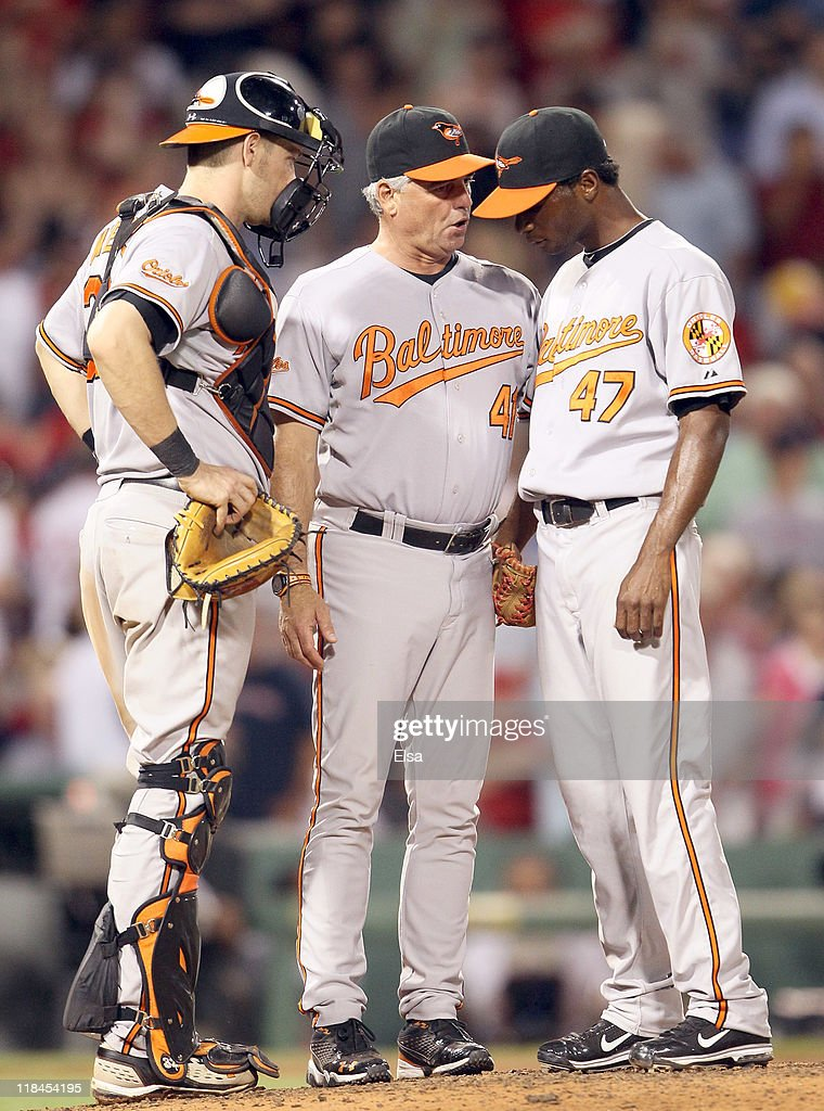 Rick Adair #41 of the Baltimore Orioles talks with Pedro Viola #47 and Matt Wieters #32 after Viola gave up three home runs in the seventh inning against the Boston Red Sox on July 7, 2011 at Fenway Park in Boston, Massachusetts.