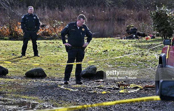 Rick Adamson operations chief for the Pierce County Sheriff's Department examines an area on Tuesday December 22 where Deputy Kent Mundell received...