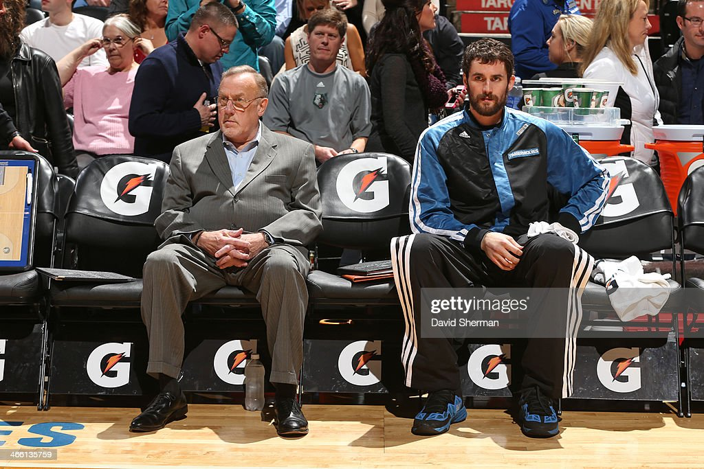 Rick Adelman and Kevin Love #42 of the Minnesota Timberwolves sit on the bench before the game against the Boston Celtics on November 16, 2013 at Target Center in Minneapolis, Minnesota.