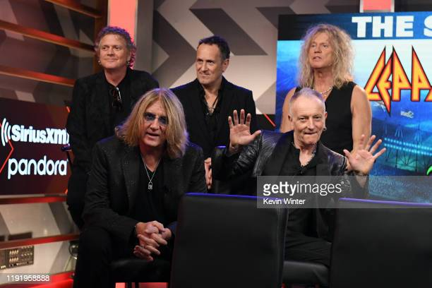 Rick Allen Joe Elliott Vivian Campbell Phil Collen and Rick Savage of Def Leppard attend the Press Conference with Mötley Crüe Def Leppard and Poison...