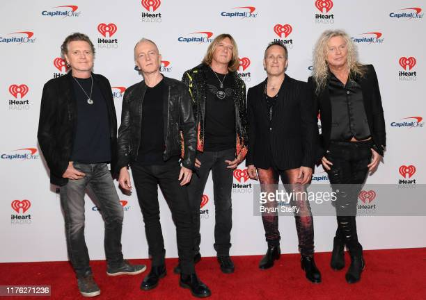 Rick Allen Phil Collen Joe Elliot Vivian Campbell and Rick Savage of Def Leppard attend the 2019 iHeartRadio Music Festival at TMobile Arena on...