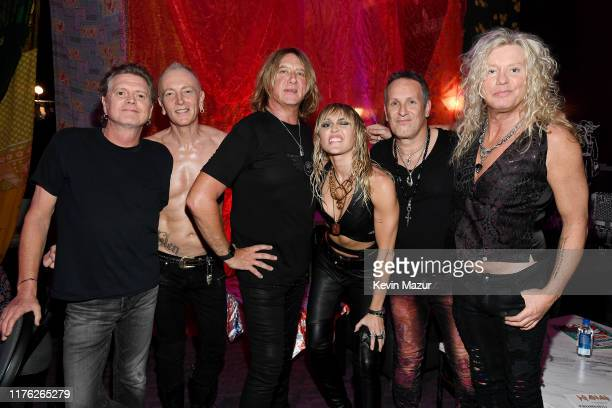 Rick Allen Phil Collen Joe Elliott Miley Cyrus Vivian Campbell and Rick Savage of Def Leppard attend the 2019 iHeartRadio Music Festival at TMobile...