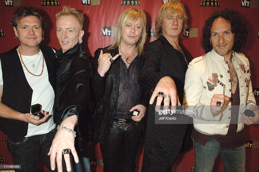Rick Allen, Phil Collen, Rick 'Sav' Savage, Joe Elliott and Vivian Campbell of Def Leppard
