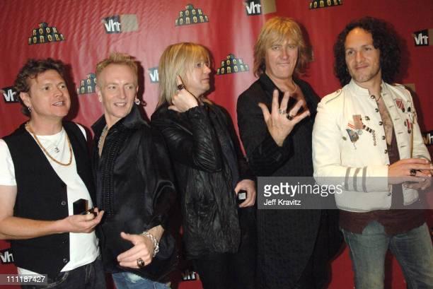 "Rick Allen, Phil Collen, Rick ""Sav"" Savage, Joe Elliott and Vivian Campbell of Def Leppard"