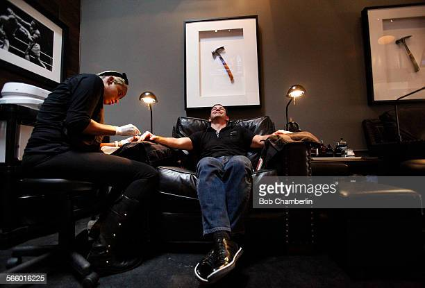 Rick Andreoli has his nails done by Naima Malone at the media opening for Hammer and Nails which bills itself as the first nail shop for men in Los...