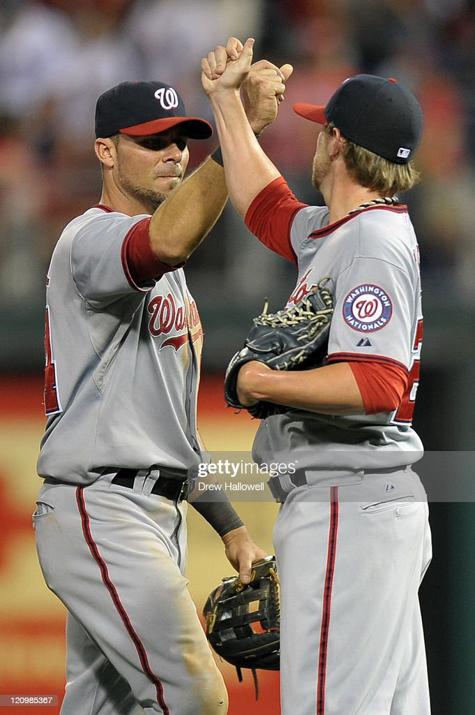 Rick Ankiel #24 and Drew Storen #22 of the Washington Nationals celebrate the 4-2 victory over the Philadelphia Phillies at Citizens Bank Park on August 12, 2011 in Philadelphia, Pennsylvania.