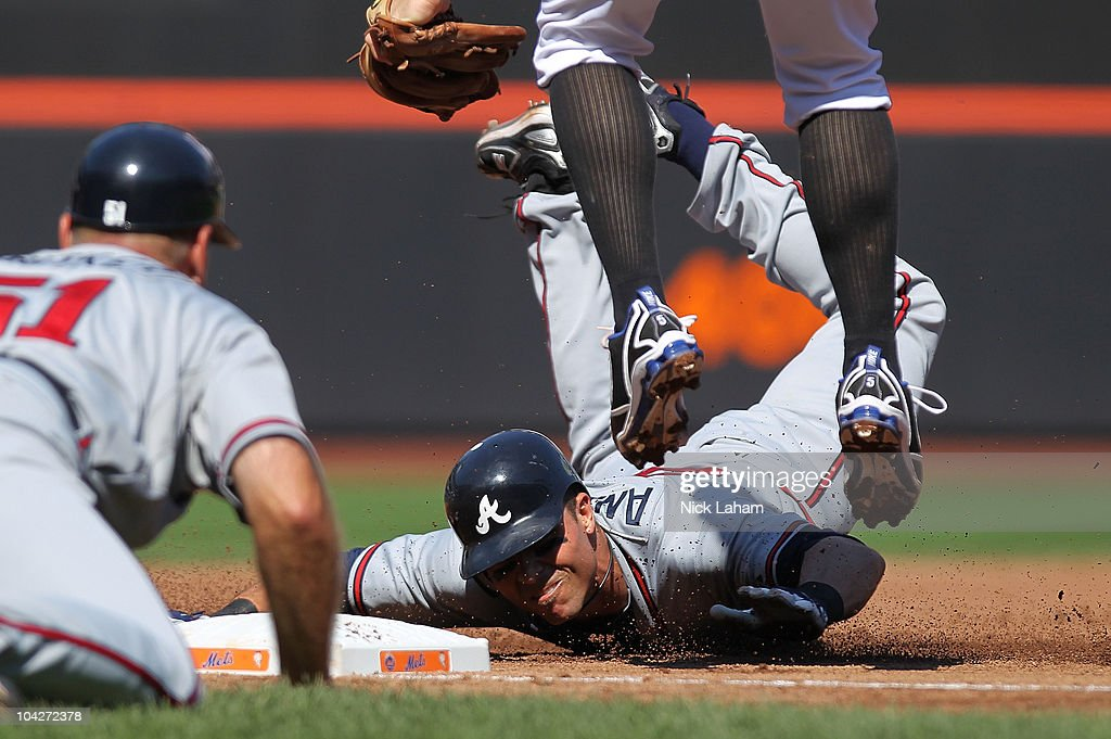 Rick Ankiel #28 of the Atlanta Braves is tagged out on a triple by David Wright #5 of the New York Mets at Citi Field on September 19, 2010 in the Flushing neighborhood of the Queens borough of New York City.