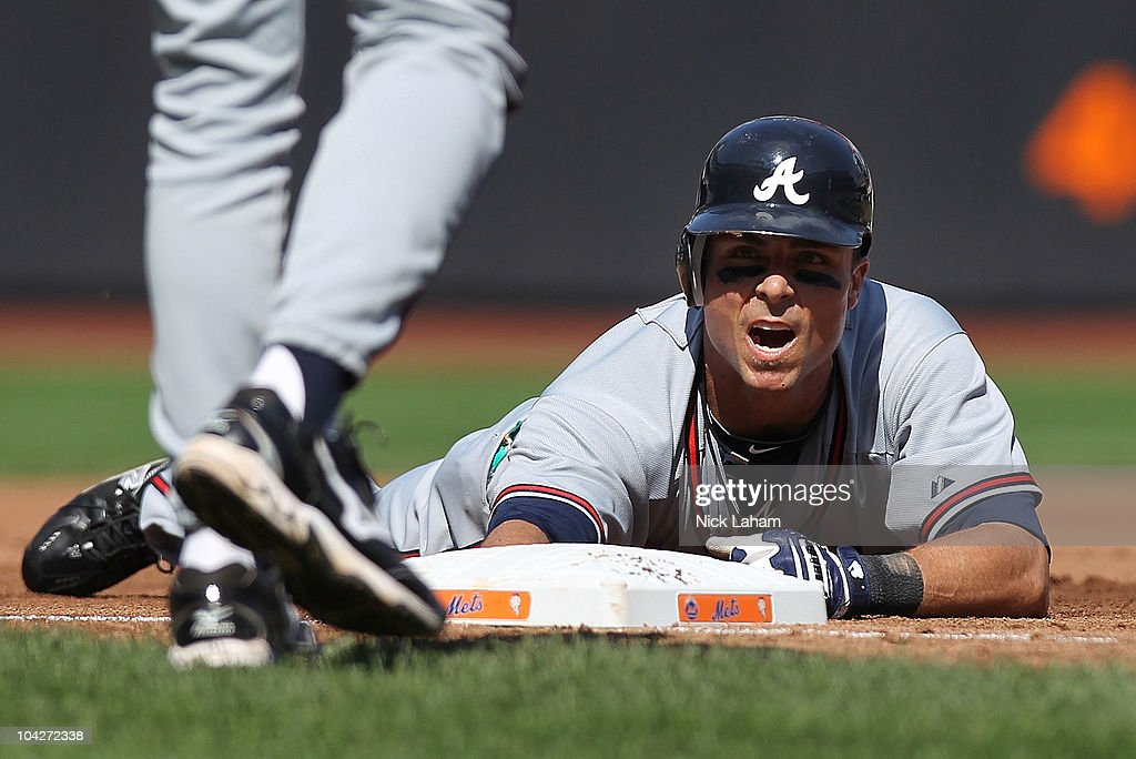 Rick Ankiel #28 of the Atlanta Braves reacts after being tagged out on a triple by David Wright #5 of the New York Mets at Citi Field on September 19, 2010 in the Flushing neighborhood of the Queens borough of New York City.