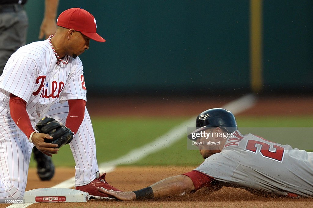 Rick Ankiel #24 of the Washington Nationals slides safe into third base on a steal before the tag by Wilson Valdez #21 of the Philadelphia Phillies at Citizens Bank Park on August 12, 2011 in Philadelphia, Pennsylvania.