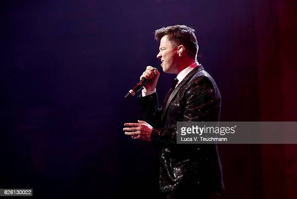 Rick Astley performs on stage during The Magic of Christmas at London Palladium on November 27 2016 in London England