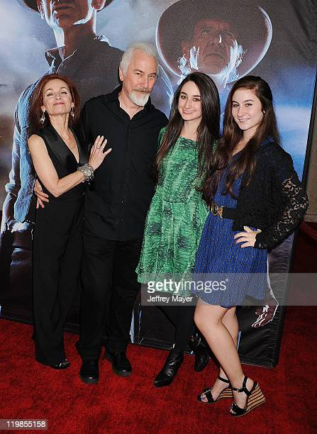 Rick Baker and wife Silvia Abascal and daughters arrive at the 'Cowboys Aliens' World Premiere at the San Diego Civic Theatre on July 23 2011 in San...