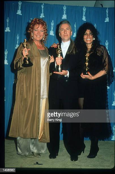 Rick Baker Ve Neill and Yolanda Toussieng attend the 67th Annual Academy Awards ceremony March 27 1995 in Los Angeles CA This year''s ceremony...