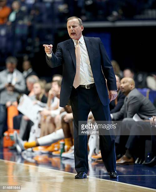 Rick Barnes the head coach of the Tennessee Volunteers gives instructions to his team during the 6765 win over the Vanderbilt Commodores during the...