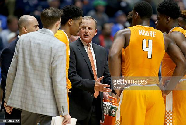 Rick Barnes the head coach of the Tennessee Volunteers gives instructions to his team during the game against the LSU Tigers during the quarterfinals...