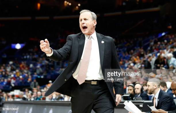 Rick Barnes the head coach of the Tennessee Volunteers gives instructions to his team against the Mississippi Bulldogs during the quarterfinals round...