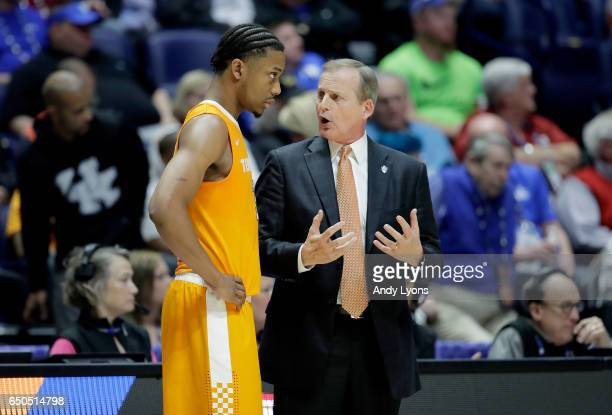 Rick Barnes the head coach of the Tennessee Volunteers talks with Robert Hubbs III against the Georgia Bulldogs during the second round of the SEC...