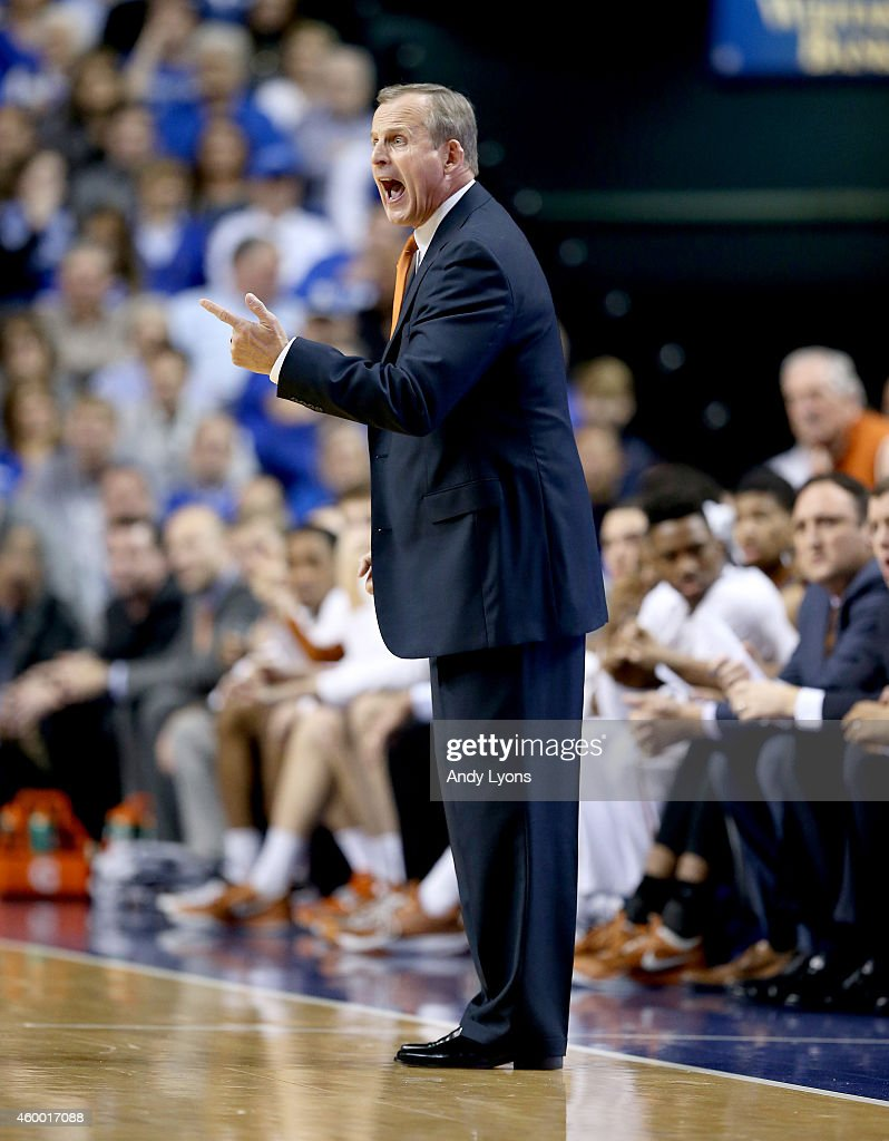 Rick Barnes the head coach of the Texas Longhorns gives instructions to his team during the game against the Kentucky Wildcats at Rupp Arena on December 5, 2014 in Lexington, Kentucky.