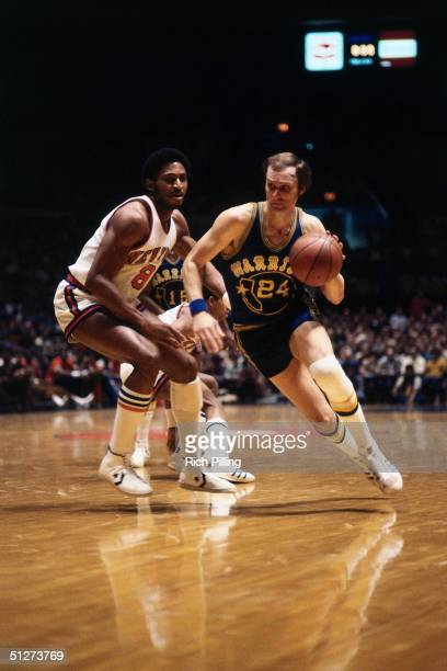 Rick Barry of the Golden State Warriors drives to the basket against the New York Knicks during a 1977 NBA season game at Madison Square Garden in...
