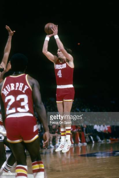 Rick Barry of the Houston Rockets shoots a jump shot against the Washington Bullets during a circa 1978 NBA basketball game at the Capital Center in...